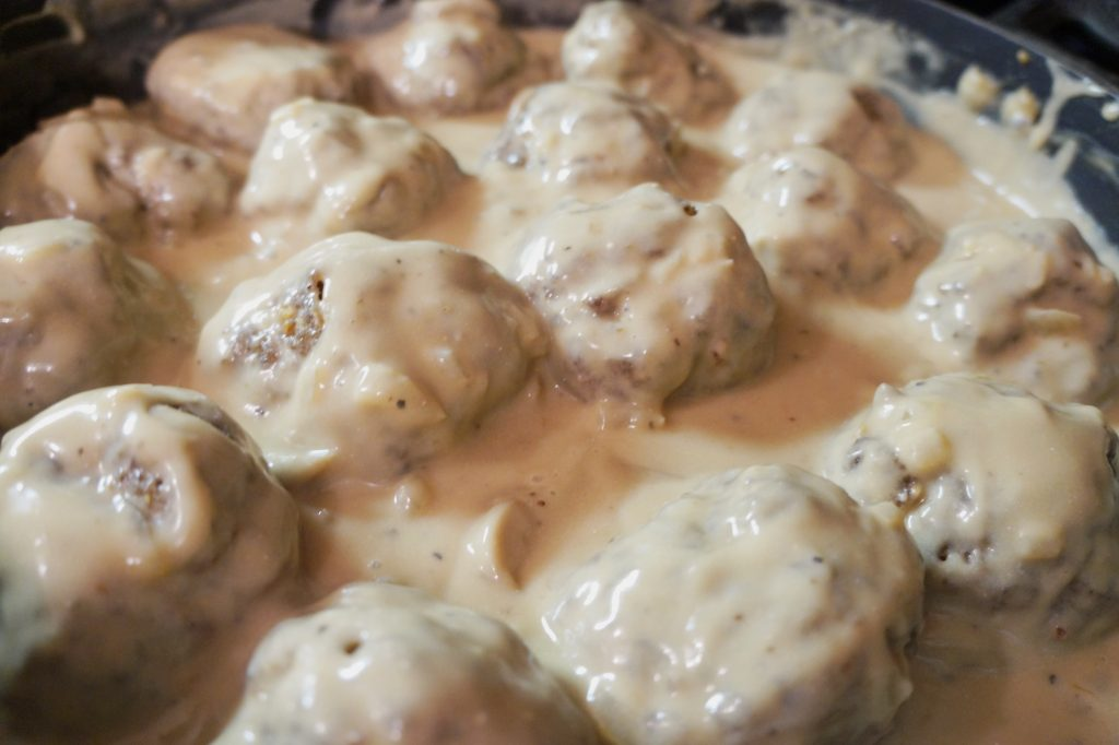 savory baked meatballs with brown mushroom gravy